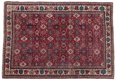 Lot 309 - Tabriz Carpet Iranian Azerbaijan, circa 1950 The blood red field with an allover design of stylised