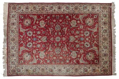 Lot 310 - Tabriz Carpet  North West Iran, circa 1950 The faded blood red field with an allover design of...