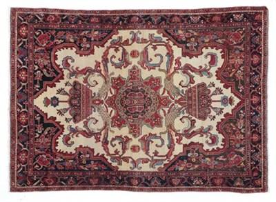 Lot 313 - Good Malayer Rug West Iran, circa 1900 The cream field of large angular tendrils around a...