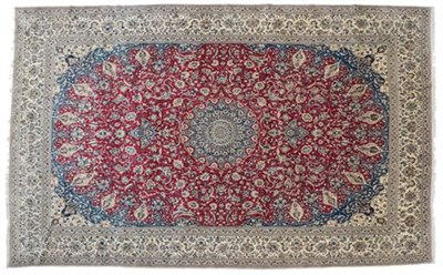 Lot 315 - Fine Nain Carpet of unusual size Central Iran, circa 1960 The blood red field centred by a sky blue