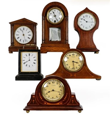 Lot 38 - An inlaid timepiece retailed by Harrods Ltd, four other mantel mahogany timepieces, and an ebonised