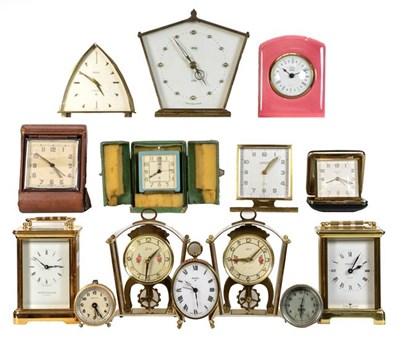 Lot 39 - A selection of timepieces, including: a Le Coultre travel alarm timepiece with outer shagreen...