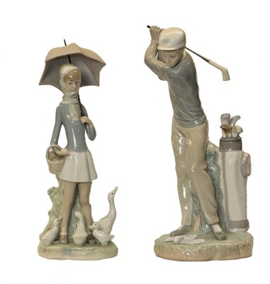 Lot 48 - A Lladro figure of a golfer, model number D-14D, and a girl & geese (2)