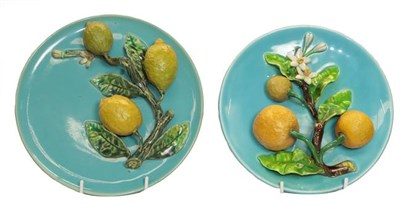 Lot 59 - A pair of 19th century Continental Majolica wall plaques applied with fruit, 25cm diameter