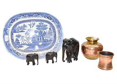 Lot 73 - An Indian copper and brass vase, a copper vase, three ebony and bone elephants, and three blue...