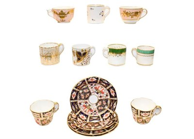 Lot 81 - A collection of 18th and 19th century Derby coffee cans, teacups and saucers, including a bute...