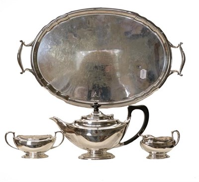Lot 87 - A silver three-piece tea service marked for London and bearing a monogram, gross weight 999...