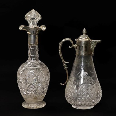 Lot 88 - A George V silver mounted cut glass decanter with three pouring spouts by Goldsmiths and...