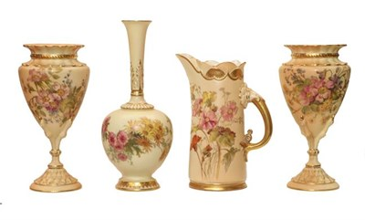 Lot 90 - A pair of Royal Worcester blush ware vases, painted with flowers and having claw form...
