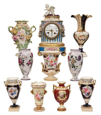 Lot 93 - A pair of Chamberlains Worcester twin-handled vases, cobalt ground and enamelled with flowers circa