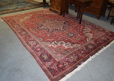 Lot 1001 - Ahar Heriz carpet, the blood red field with a central flower head medallion framed by...