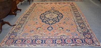 Lot 1003 - Tabriz carpet, the soft terracotta field of vines around an indigo medallion, framed by angular...