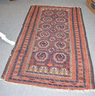 Lot 1005 - Baluch rug, the pale aubergine field of salor guls enclosed by multiple borders 183cm by 112cm