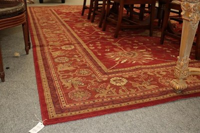 Lot 1012 - A machine made carpet of Zeigler design, the deep terracotta field with an all over design of large