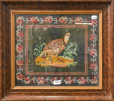Lot 1059 - Two woolwork tapestries, frames and glazed, a partridge and a golden pheasant, partridge 39cm...