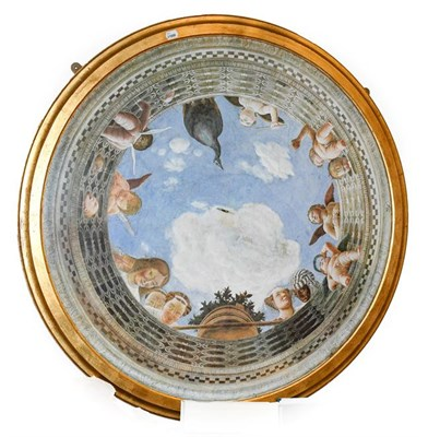 Lot 1074 - A pair of circular ceiling mounted panels, modern in the Renaissance style, with moulded silver and