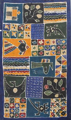 Lot 1083 - A large Indonesian Batik, decorated with animals and geometric designs over a dark blue ground,...