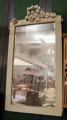 Lot 1090 - A 19th century bevelled mirror white painted mirror frame with floral surmount, 85cm by 160cm