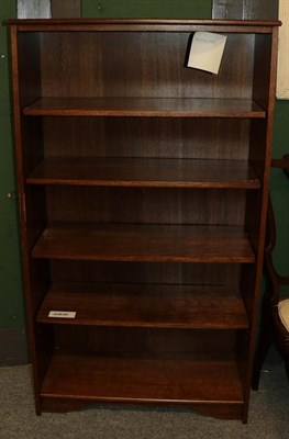 Lot 1091 - An oak open bookcase, 77cm by 30cm by 137cm, a G Plan style nest of three tables and a mid 20th...