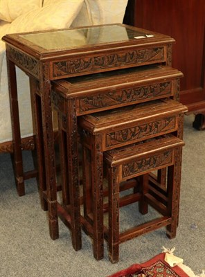 Lot 1095 - A 20th century Chinese heavily carved nest of four occasional tables, 50cm by 36cm by 65cm