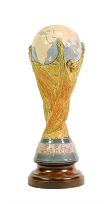 Lot 3006 - Lladro Model Of The Fifa World Cup designed by Bertoni of Italy, raised on turned wooden...