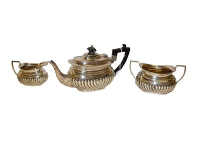 Lot 6 - A three-piece Victorian silver tea-service, London, 1895, each piece with part-fluted lower...