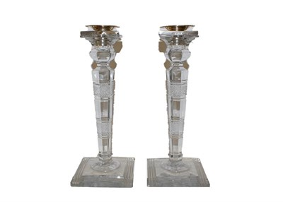 Lot 12 - A pair of George VI silver mounted cut glass candlesticks, the silver mounts by John Grinsell &...