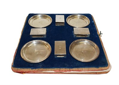 Lot 17 - A set of four match box holders and four ashtrays, William Comyns, London 1929, engraved with...