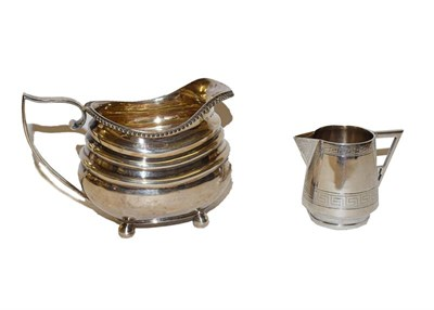 Lot 29 - A George III silver milk jug, probably by Solomon Hougham, London, 1795, 14cm long, together with a