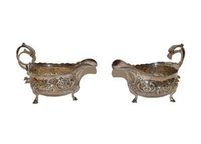 Lot 30 - A pair of George III silver sauceboats, by William Sumner, London, 1785, each on three pad feet and