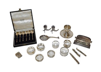 Lot 42 - A collection of assorted silver, including six various napkin rings, a cup on stand, a pair of...