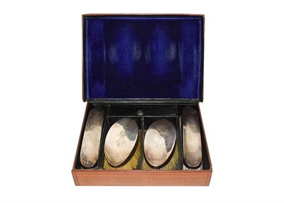 Lot 46 - A set of four silver brushes, William Comyns, London 1910, in a fitted leather case, engraved...