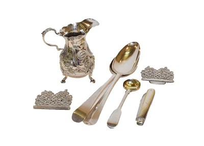 Lot 68 - A collection of silver, including a George II silver cream jug, a nurses belt, a silver and...