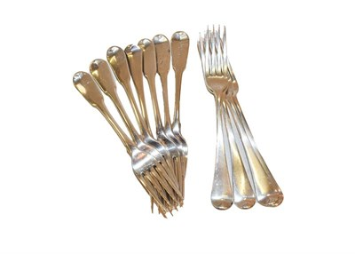 Lot 75 - A collection of George III silver table forks decorated in Old English and Fiddle pattern,...