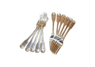 Lot 77 - A set of eleven silver dessert forks decorated in the Fiddle pattern, 14oz 8dwt, 447gr