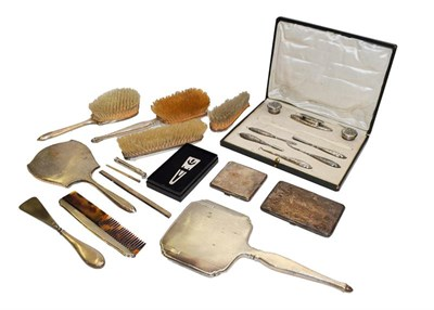 Lot 87 - A collection of assorted silver, including a part dressing table service, two differing...