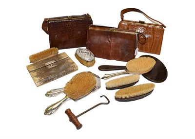 Lot 89 - A snakeskin manicure case with mother of pearl fittings, a silver backed hand mirror and brush,...