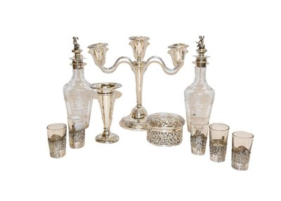 Lot 91 - A collection of assorted silver, including a three-light candelabra, a dressing table box,...