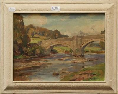 Lot 1013 - Owen Bowen (1873-1967) A bridge over a river, signed oil on canvas, 29cm by 39cm