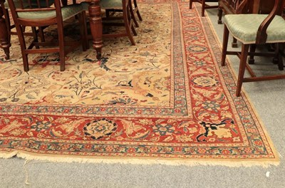 Lot 1078 - Oriental Carpet, the cream field of scrolling tendrils flowers and plants around a medallion framed