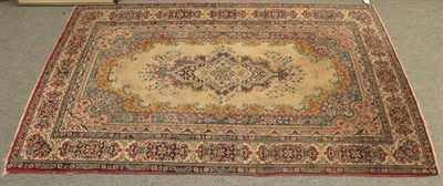 Lot 1079 - Indian Rug, the ivory field with central cartouche framed by multiple floral borders,  221cm by...