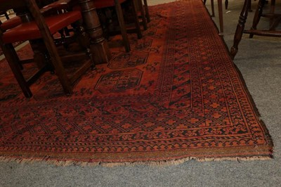 Lot 1081 - Afghan Ersari Carpet, the madder field with columns of 'elephant foot' guls enclosed by stellar...