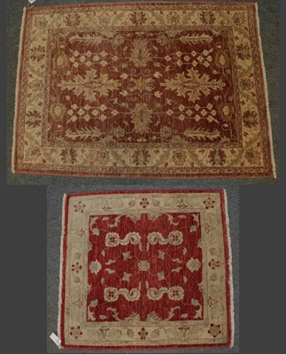 Lot 1083 - Afghan 'Ziegler' rug, the shaded field of large serrated leaves and plants enclosed by cream...