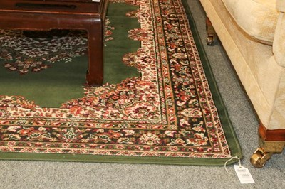 Lot 1084 - Machine made Rug of oriental design, the British racing green field with central medallion...