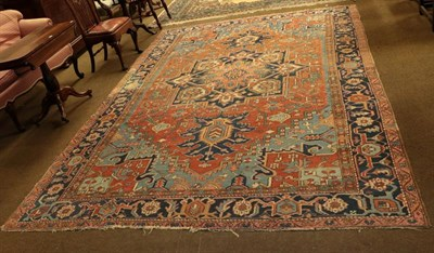 Lot 1085 - Heriz Carpet, the terracotta field of angular vines centred by a typical medallion framed by...