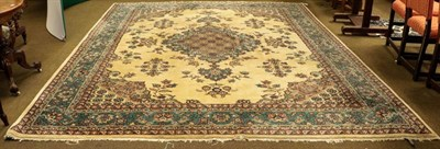 Lot 1086 - A large Oriental carpet, probably Isparta, the ivory field with floral sprays around a...