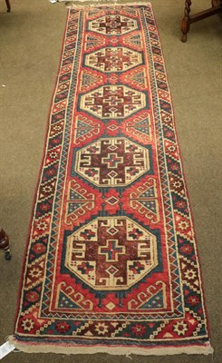 Lot 1087 - Dosemalti Runner, the soft raspberry field with a column of octagons framed by polychrome...