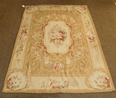 Lot 1090 - Chinese neddlepoint rug of Aubusson design the field with a panel of naturalistic roses enclosed by
