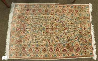 Lot 1092 - Hereke silk prayer rug, the ivory field with issuing flowers beneath the Mihrab framed by upper...