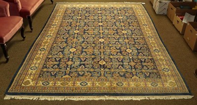 Lot 1093 - Indian rug of Perepdil design, the indigo field of rams horn motifs and flower heads enclosed...